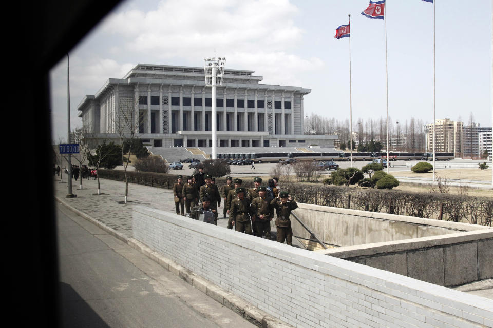 North Korean soldiers walk to an underpass in Pyongyang, North Korea, Wednesday, April 11, 2012. (AP Photo/Ng Han Guan)