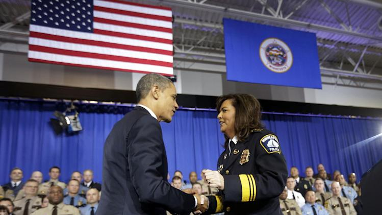 President Barack Obama is introduced by Minneapolis Police Chief, Janee Harteau before speaking on ideas to reduce gun violence, Monday, Feb. 4, 2013,  at the Minneapolis Police Department Special Operations in Minneapolis, Minn. (AP Photo/Pablo Martinez Monsivais)