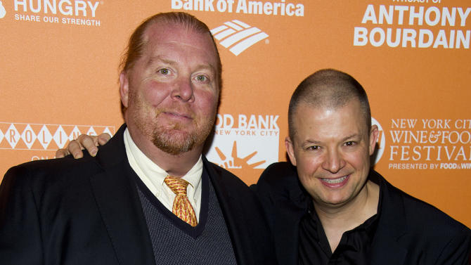 "Mario Batali, left, and Jim Norton attend ""On The Chopping Block: A Roast of Anthony Bourdain"" on Thursday, Oct. 11, 2012 in New York. (Photo by Charles Sykes/Invision/AP Images)"