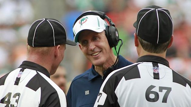 Miami Dolphins head coach Joe Philbin (C) speaks with officials (Reuters)