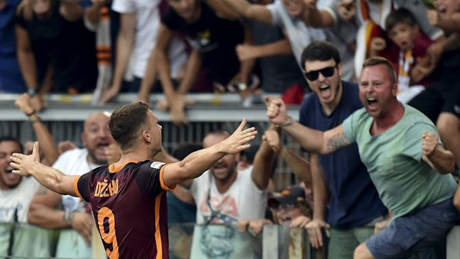 AS Roma's Dzeko celebrates after scoring against Juventus during their Serie A soccer match at Olympic stadium in Rome