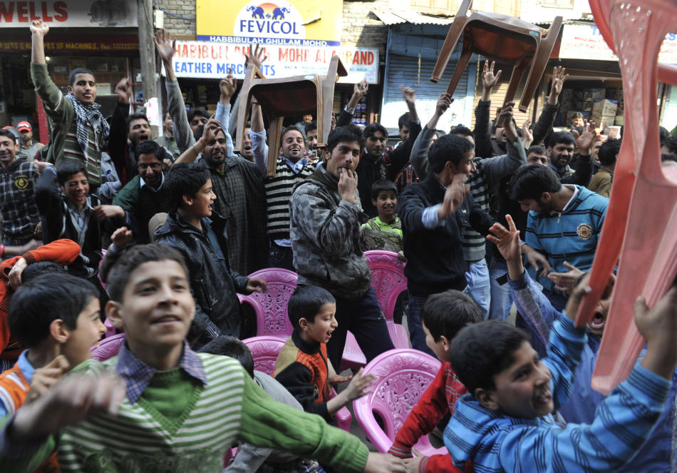 Kashmiris celebrate the dismissal of Ind