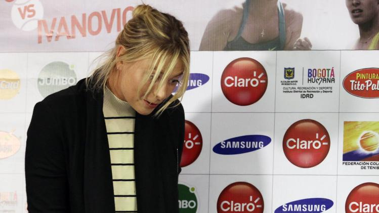 Russia's Maria Sharapova talks with children after a news conference in Bogota