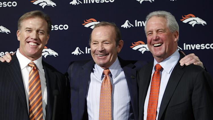 In this Jan. 14, 2011 file photo, John Fox, right, the then-new head football coach of the NFL team Denver Broncos, poses for a photo with owner Pat Bowlen , center, and John Elway, Executive V.P. of football operations,  at the teams headquarters in Englewood, Colo. Bowlen is giving up control of the team as he battles Alzheimer's disease. The team announced Wednesday, July 23, 2014 that the 70-year-old Bowlen will no longer be a part of the team's daily operations. Team president Joe Ellis will take over after being named as the Broncos' chief executive officer