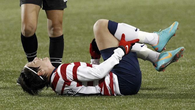 United States forward Abby Wambach holds her leg after she was fouled during the first half of an exhibition soccer match against Ireland in Portland, Ore., Wednesday, Nov. 28, 2012. (AP Photo/Don Ryan)