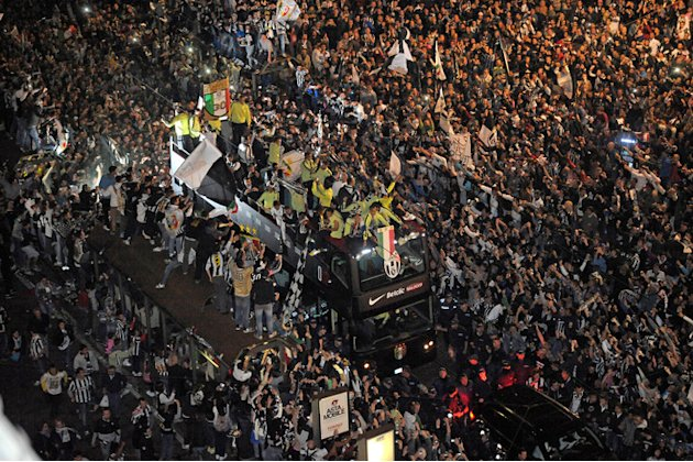 The Bus Of Juventus Football Team Crosses The Crowded Centre Of Turin To Celebrate Their Italian Serie A Football AFP/Getty Images