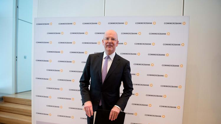 "Martin Blessing , CEO of Germany's Commerzbank , arrives for a balance press conference in Frankfurt, Germany , Friday Feb. 15, 2013.  Germany's Commerzbank says it's making progress in reshaping its business but still has ""a long way to go"" as higher shipping loan losses and low interest rates continue to squeeze profits.  The bank provided detail Friday on its fourth-quarter earnings announced Feb. 4. It lost 716 million euro (US$954 million) largely due to one-time losses of 185 million euro on its sale of Bank Forum in Ukraine and 560 million euro in tax accounting charges. For all of 2012, net profit was a meager 6 million euro as loan losses increased and interest earnings shrank. (AP Photo/dpa, Boris Roessler)"