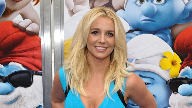 "FILE - In this July 28, 2013 file photo, singer Britney Spears arrives to the world premiere of ""The Smurfs 2"" in Los Angeles. Caesars Entertainment says pop star Britney Spears will get a key to the Las Vegas Strip and celebrate with her own dedicated day. The Las Vegas-based casino giant announced Thursday, Oct. 23, 2014 it would host ""Britney Day"" at The LINQ Promenade starting at 5:30 p.m. Nov. 5. (Photo by John Shearer/Invision/AP, File)"