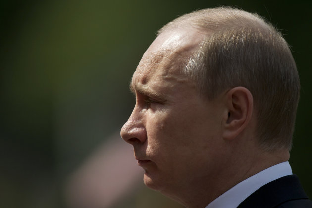 Russian President Vladimir Putin takes part in a wreath laying ceremony at the Tomb of the Unknown Soldier outside Moscow's Kremlin Wall, Russia, Friday, June 22, 2012, to mark the 71th anniversary of the Nazi invasion of the Soviet Union. (AP Photo/Alexander Zemlianichenko)