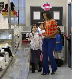 First lady Michelle Obama visits the cafeteria as she has lunch with school children at Parklawn elementary school in Alexandria, Va., Wednesday, Jan., 25, 2012. (AP Photo/Pablo Martinez Monsivais)