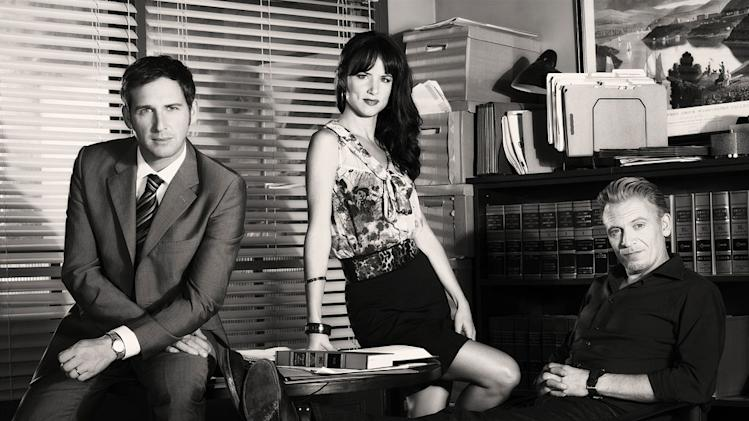 "Josh Lucas as Mitch McDeere, Juliette Lewis as Tammy Hemphill, and Callum Keith Rennie as Ray McDeere in ""The Firm."""