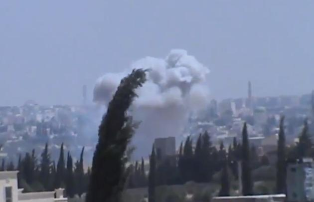 In this image taken from video obtained from the Shaam News Network, which has been authenticated based on its contents and other AP reporting, columns of smoke billowing as a result of heavy bombing,