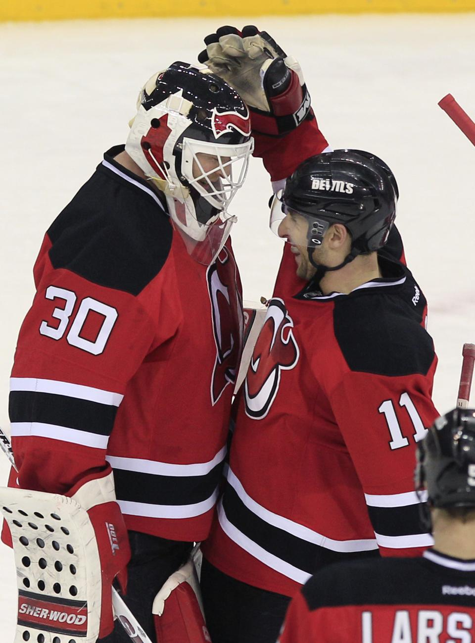 New Jersey Devils' Stephen Gionta, right, celebrates with goalie Martin Brodeur after the Devils defeated the Ottawa Senators 4-2 in an NHL hockey game in Newark, N.J., Saturday, April 7, 2012. (AP Photo/Mel Evans)