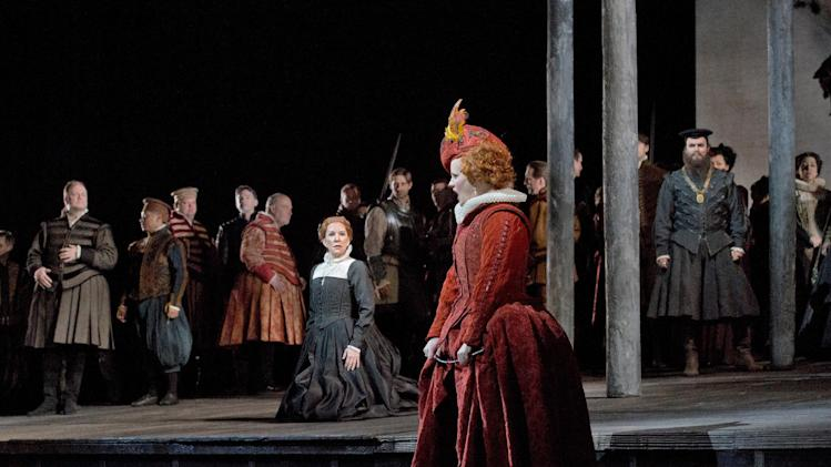 "In this Dec. 24, 2012 photo provided by the Metropolitan Opera,  Elza van den Heever, center right, sings the role of  Elisabetta with Joyce DiDonato, center left, in the title role during a dress rehearsal of Donizetti's ""Maria Stuarda,"" at the Metropolitan Opera in New York. (AP Photo/Metropolitan Opera, Ken Howard)"