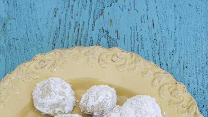 In this image taken on Feb. 18, 2013, lemon wedding cookies are shown served on a plate in Concord, N.H. (AP Photo/Matthew Mead)