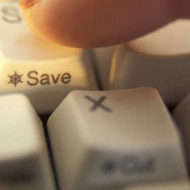 Finger-hitting-the-save-button_web