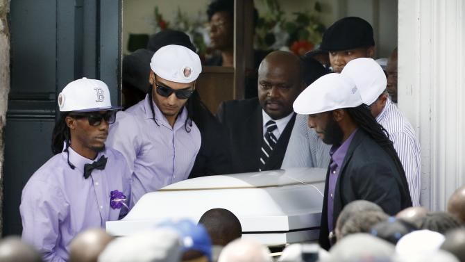 Pallbearers carry the casket of Odin LLoyd following a funeral ceremony at the Church of the Holy Spirit in Boston in Boston, Saturday, June 29, 2013. Hundreds of relatives, friends and well-wishers wept together and hugged at the funeral for LLoyd, a semi-pro football player whose killing led to murder and weapons charges against former New England Patriots player Aaron Hernandez. (AP Photo/Michael Dwyer)