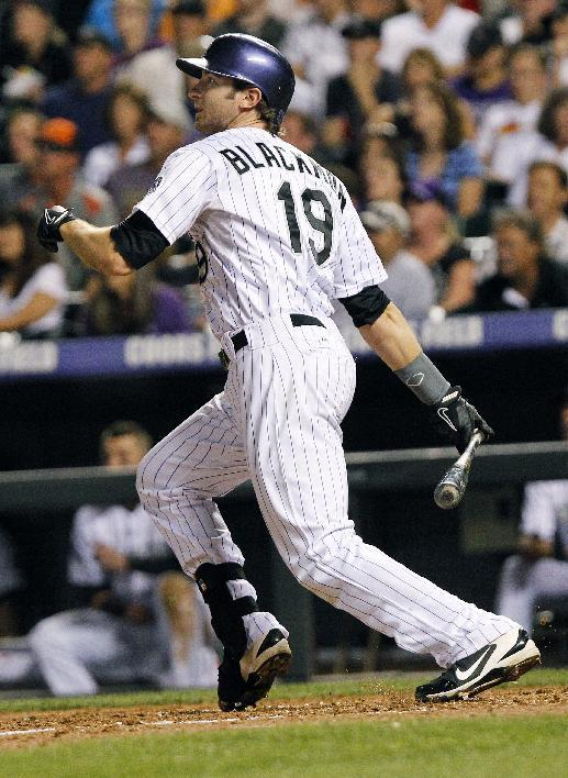 Helton hits 2 HRs, drives in 6 as Rockies top Reds