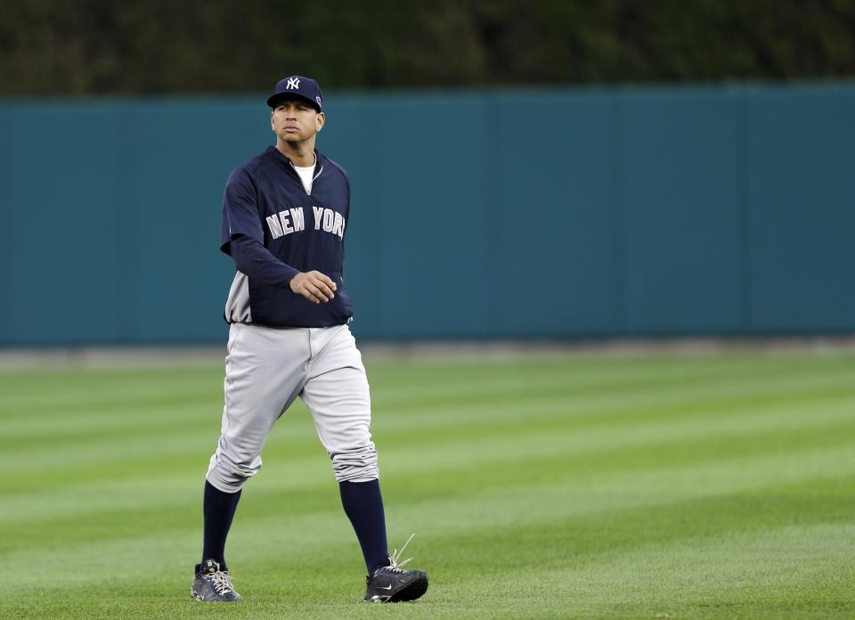 New York Yankees' Alex Rodriguez walks back to the dugout during a workout before Game 3 of the American League championship series against the Detroit Tigers Tuesday, Oct. 16, 2012, in Detroit. (AP Photo/Paul Sancya )