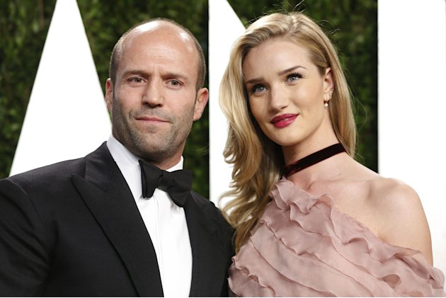 Jason Statham (L) with girlfriend Rosie Huntington-Whiteley attend the 2013 Vanity Fair Oscars Party in West Hollywood