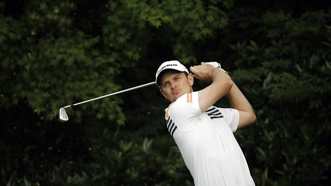 Justin Rose, of England, watches his tee shot on the 11th hole during the first round of the U.S. Open golf tournament at Merion Golf Club, Thursday, June 13, 2013, in Ardmore, Pa. (AP Photo/Morry Gash)