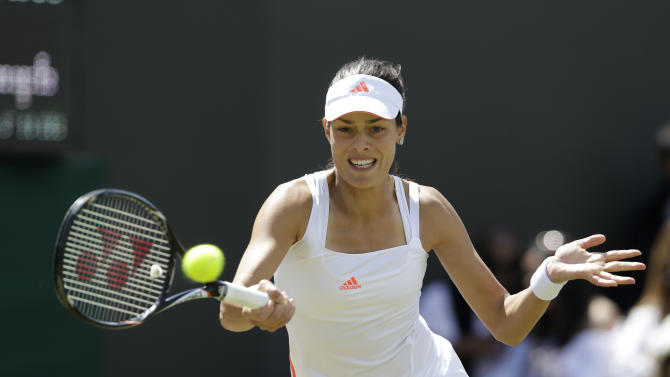 Ana Ivanovic of Serbia returns a shot to Julia Goerges of Germany during a third round women's singles match at the All England Lawn Tennis Championships at Wimbledon, England, Saturday, June 30, 2012. (AP Photo/Kirsty Wigglesworth)