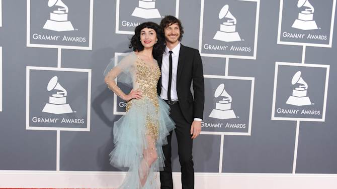 Kimbra, left, and Gotye arrive at the 55th annual Grammy Awards on Sunday, Feb. 10, 2013, in Los Angeles.  (Photo by Jordan Strauss/Invision/AP)