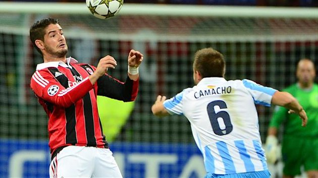 AC Milan's Brazilian forward Pato (L) fights for the ball with Malaga's defender Ignacio Camacho during the Champions league football match AC Milan vs Malaga