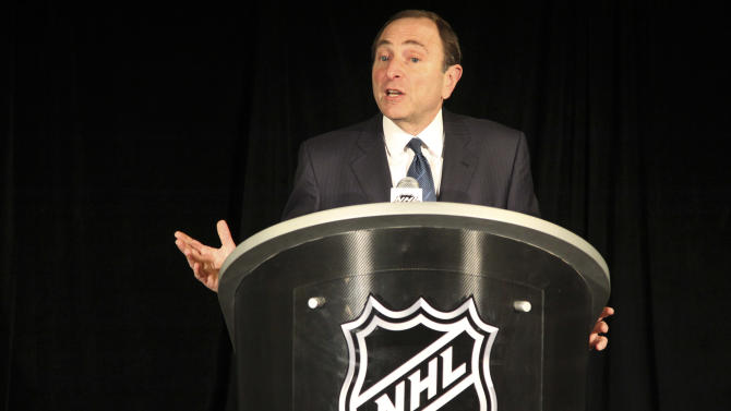 NHL commissioner Gary Bettman speaks to reporters after an NHL Board of Governors meeting, Wednesday, Dec. 5, 2012 in New York.  The league and the players' association have cleared their schedules with progress being made in collective bargaining talks. (AP Photo/Mary Altaffer)