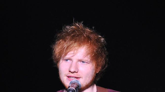 """Songwriter Ed Sheeran performs at """"Play It Forward: A Celebration of Music's Evolution and Influencers"""" at the Grammy Foundation's 15th Annual Music Preservation Project, Thursday, Feb. 7, 2013, in Los Angeles. (Photo by Vince Bucci/Invision/AP)"""