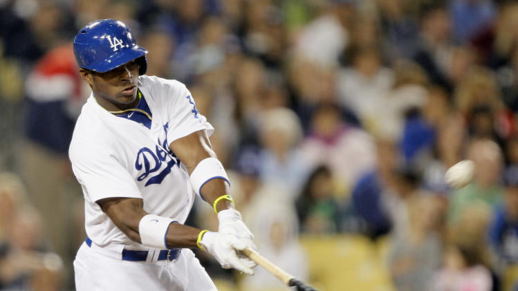 Los Angeles Dodgers' Yasiel Puig hits a solo home run against the Atlanta Braves in the sixth inning of a baseball game Friday, June 7, 2013, in Los Angeles. (AP Photo/Alex Gallardo)