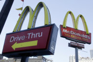 "<p> FILE - In this Dec. 20, 2010 file photo, McDonald's signs sprout from the restaurant's parking lot in New York. McDonald's says a key sales figure edged up modestly in July, 2013, as the Dollar Menu and Big Macs in the U.S. helped offset declines in other parts of the world. The world's biggest hamburger chain says global sales rose 0.7 percent at restaurants open at least 13 months. That included a 1.6 percent increase in the U.S., where it said ""everyday value offerings,"" breakfast and staples such as the Big Mac drove up results. (AP Photo/Richard Drew, file)"
