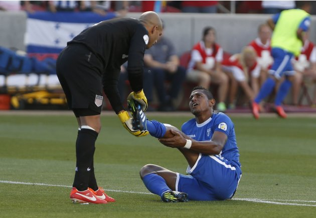 U.S. goalkeeper Tim Howard checks on an injured Honduras' Carlo Costly during their 2014 World Cup qualifying soccer match in Salt Lake City, Utah