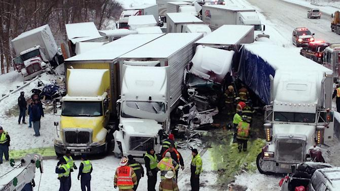 UPDATES NUMBER OF VEHICLES INVOLVED - In this photo provided by the Indiana State Police, emergency crews work at the scene of a massive pileup involving more than 40 vehicles, many of them semitrailers, along Interstate 94 Thursday afternoon, Jan. 23, 2014 near Michigan City, Ind. At least three were killed and more than 20 people were injured. (AP Photo/Indiana State Police)