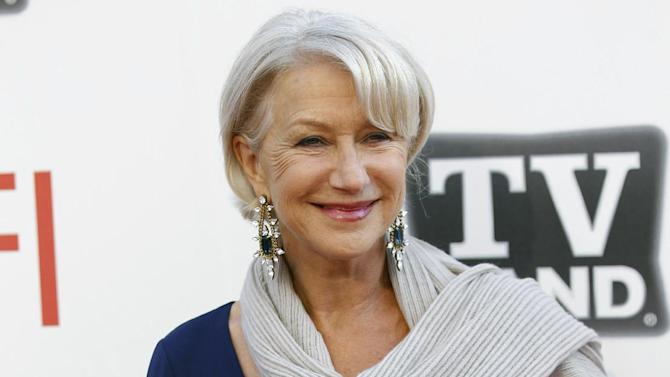 """FILE - In this June 9, 2011 file photo, actress Helen Mirren arrives at the taping of """"TV Land Presents: AFI Life Achievement Award Honoring Morgan Freeman"""" in Culver City, Calif. Gray heads have been popping up on runways and red carpets, on models and young celebrities for months. There's Lady Gaga and Kelly Osbourne _ via dye _ and Hollywood royalty like Oscar-winning British actress Helen Mirren. (AP Photo/Matt Sayles, file)"""