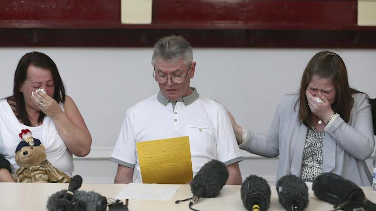 "Family members of murdered British soldier Lee Rigby, from left to right, his mother Lyn, stepfather Ian, and his wife Rebecca Rigby, as his stepfather reads a statement during a press conference at the Regimental HQ of his unit, the Royal Regiment of Fusiliers at Bury in Greater Manchester, England, Friday May 24, 2013. Ian Rigby thanked people for their support and including the tribute ""You fought bravely and with honour died"".  Drummer Lee Rigby had served in Afghanistan and was attached to the Regimental Recruiting Team when he was hacked to death in broad daylight on Wednesday afternoon in Woolwich, south-east London. Two suspects were shot and arrested at the scene and remain in police custody. (AP Photo/Dave Thompson)"