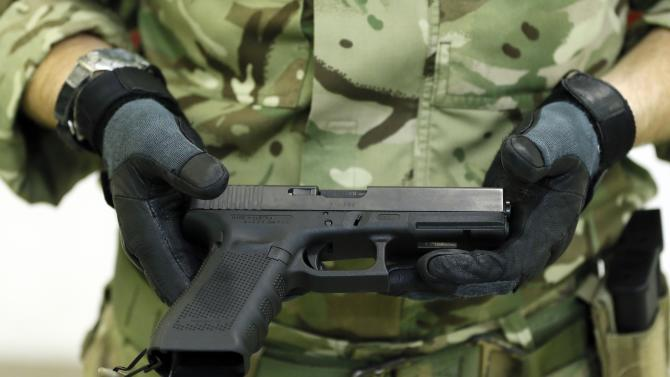 A Glock 17 Gen 4 pistol is presented during a media opportunity at the Royal Artillery Barracks in London, Wednesday, Jan. 9, 2013. The defense ministry has signed a 9 million pound ($13.6 million) contract to provide the Armed Forces with more than 25,000 new Glock sidearms. (AP Photo/Kirsty Wigglesworth)