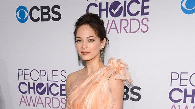 "WORST: Kristin Kreuk.  Did the ""Beauty and the Beast"" star get lost on the way to a winter formal? Though the peach gown is a lovely color on Kristin, the sequined bottom paired with the frothy top looks a bit junior."