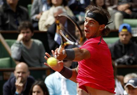 Nadal of Spain returns the ball to his compatriot Ferrer during their men's singles semi-final match at the French Open tennis tournament at the Roland Garros stadium in Paris