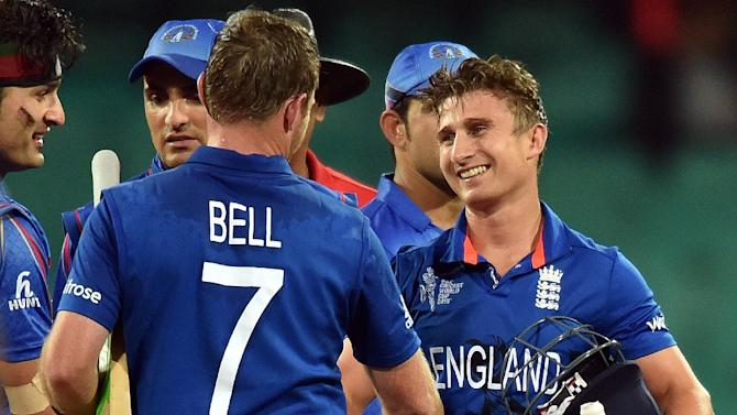 England's batsmen James Taylor (R) and Ian Bell celebrate their victory over Afghanistan during the 2015 Cricket World Cup Pool A match on March 13, 2015