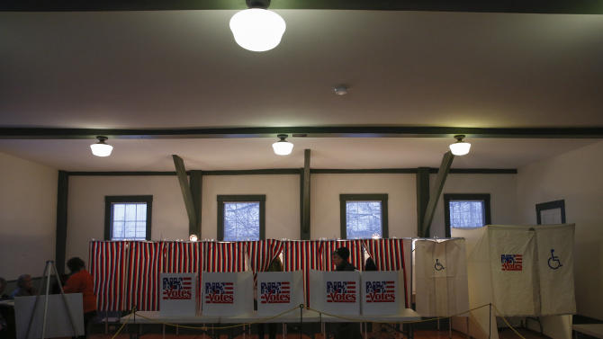 People are seen voting inside the Canterbury Town Hall polling station in Canterbury, New Hampshire