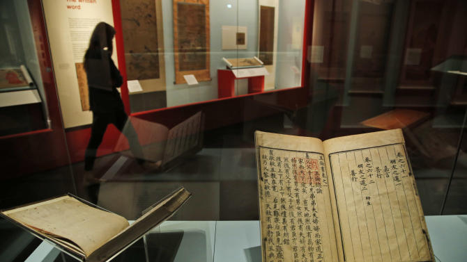 In this Monday, Sept. 15, 2014 photo, woodblock-printed ink on paper books, including a book, right, dated 1447, right, entitled the book of the five human relationships, are seen at an exhibition entitled 'Ming 50 years that changed China' in British Museum in central London. Between AD 1400 and 1450, China was a global superpower run by one family – the Ming dynasty – who established Beijing as the capital and built the Forbidden City. The exhibition, running from Sept. 18, 2014 to Jan 5, 2015, will feature a range of these spectacular objects – including exquisite porcelain, gold, jewellery, furniture, paintings, sculptures and textiles – from museums across China and the rest of the world. (AP Photo/Lefteris Pitarakis)