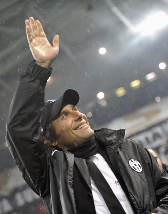 Juventus coach Antonio Conte waves before their Champions League soccer match against Celtic at Juventus stadium in Turin