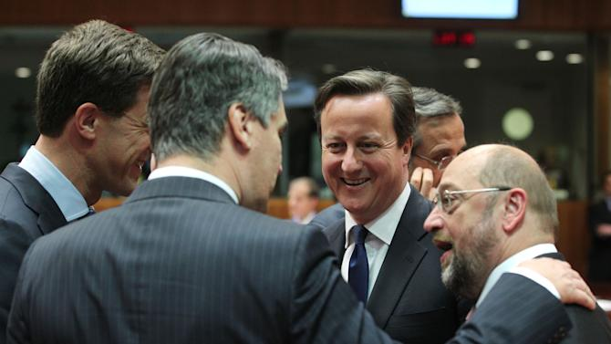 European Parliament President Martin Schulz, right, talks with British Prime Minister David Cameron, second right, Croatia's Prime Minister Zoran Milanovic, second left, and Dutch Prime Minister Mark Rutte at an EU summit in Brussels on Wednesday, May 22, 2013. Leaders from the 27 European Union countries gather in Brussels for one of their regular European Council sessions. On the agenda is the increasingly controversial subject of tax evasion. (AP Photo/Yves Logghe)
