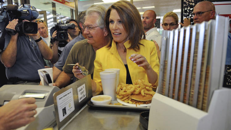 Republican presidential candidate, Rep. Michele Bachmann, R-Minn., pays for her order of  Chili Cheese A/Plenty, Tuesday, Aug. 16, 2011, at the Beacon Drive-in , in Spartanburg, S.C. (AP Photo/ Richard Shiro)