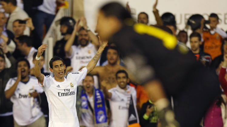 Real Madrid's Angel Dimaria celebrates his goal in front of Barcelona's goalkeeper Jose Manuel Pinto during King's Cup final soccer match in Valencia