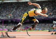 South Africa's Oscar Pistorius starts his men's 400m round 1 heats at the London 2012 Olympic Games at the Olympic Stadium in this August 4, 2012 file photo. South African paralympic star Oscar Pistorius is being questioned by South African police for shooting his girlfriend, domestic media said on February 14, 2013. Johannesburg's Talk Radio 702 said Pistorius was understood to have shot his girlfriend in the head and arm, although the circumstances surrounding the incident were unclear. He may have mistaken her for a burglar, the radio report said. REUTERS/Dylan Martinez/Files (BRITAIN - Tags: SPORT OLYMPICS ATHLETICS)