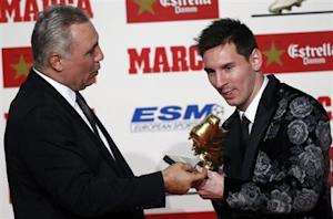 Barcelona's soccer player Messi receives the Golden Boot trophy from former player Stoichkov during an award ceremony in Barcelona