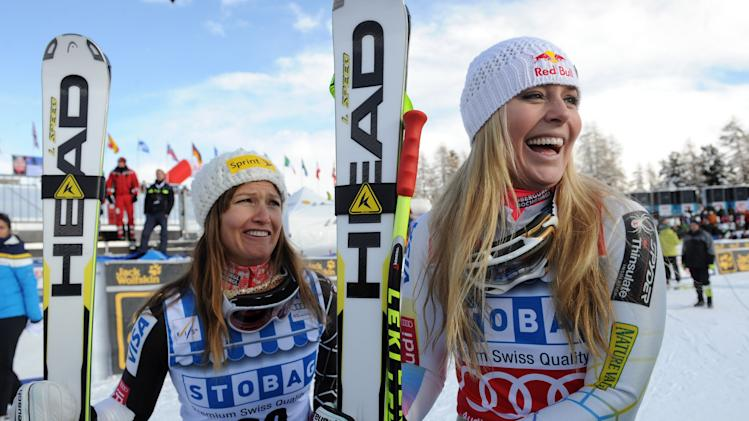 Lindsey Vonn, right, of the United States, celebrates with her teammate third placed Julia Mancuso, after winning an alpine ski, women's World Cup super-G, in St. Moritz, Switzerland, Saturday, Dec .8, 2012. (AP Photo/Giovanni Auletta)