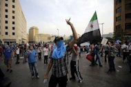 Supporters of the 'March 14' movement -- who oppose the Syrian regime -- protest in Beirut. Lebanese police fired in the air and used tear gas on Sunday to repel protesters trying to storm the premier's office, amid calls for him to quit after a top security official was killed by a car bomb blamed on Syria